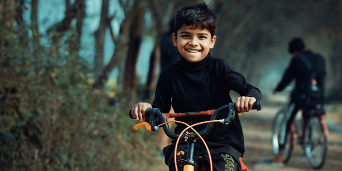 A child rides his bike to get exercise