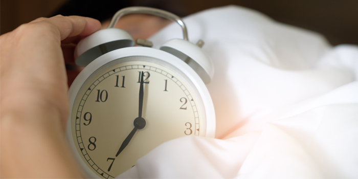 An alarm clock in bed